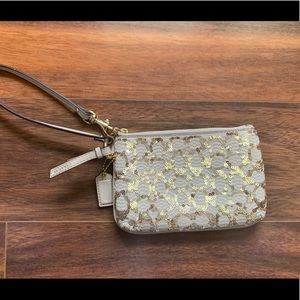 Gold sequence coach Wristlet